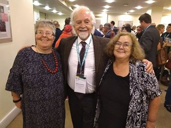 Heather from VALID standing with Judy from Speak Out and Klaus Lachwitz, President from Inclusion International
